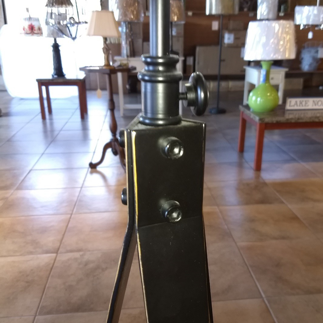 Iron tripod lamp closeup